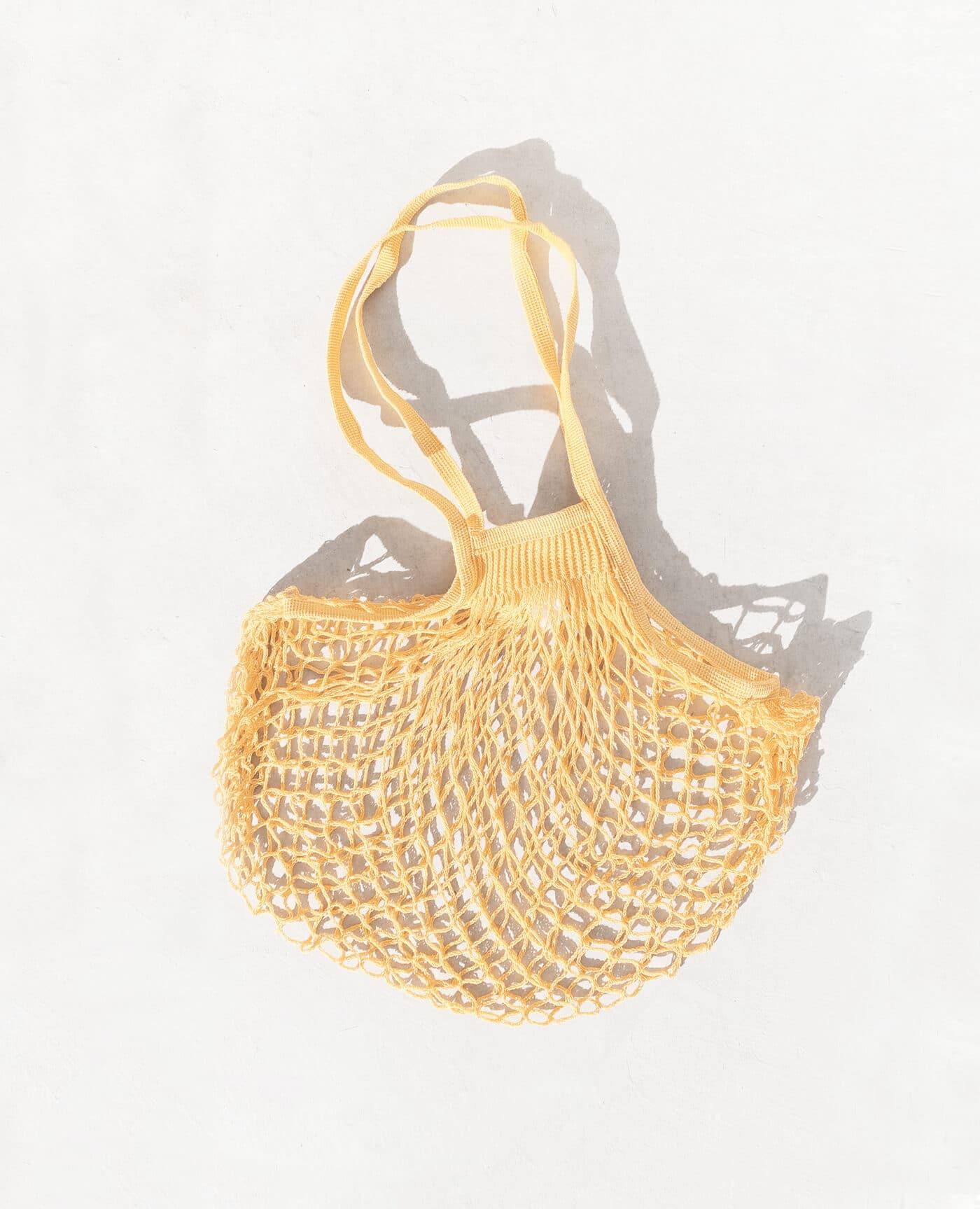 Sac filet à provision vegan avec un look vintage de la marque Filt 1860 Made in France de couleur jaune gold