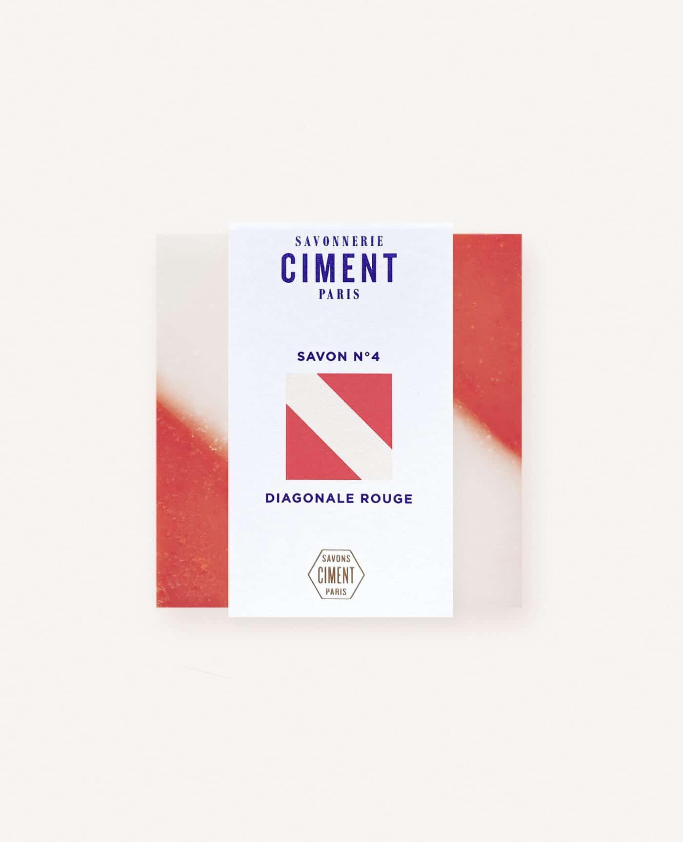 Savon solide bio et vegan de la marque Ciment Paris avec un motif esprit carreau de ciment diagonale rouge à la senteur crème de miel made in france